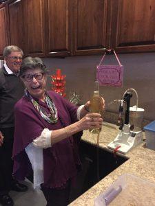 Happy Women with Wine Bottle