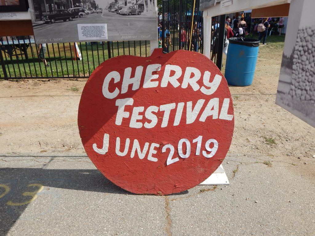 cherry festival apple sign